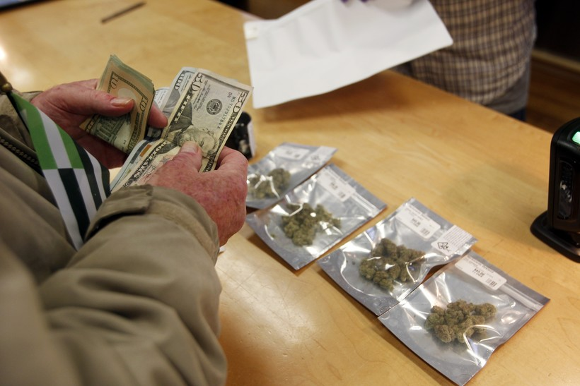 Person pays cash for bags of marijuana