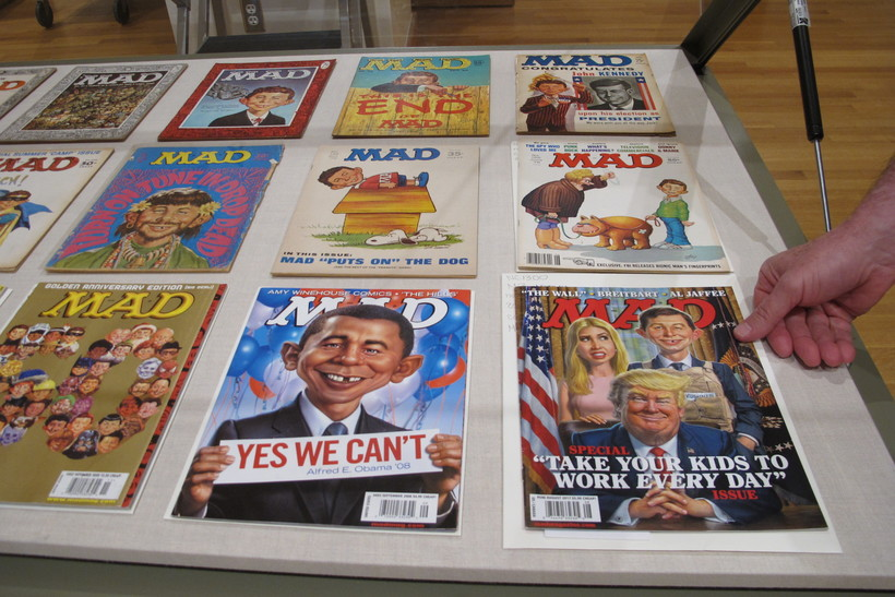 Various issues of Mad magazine displayed on a table