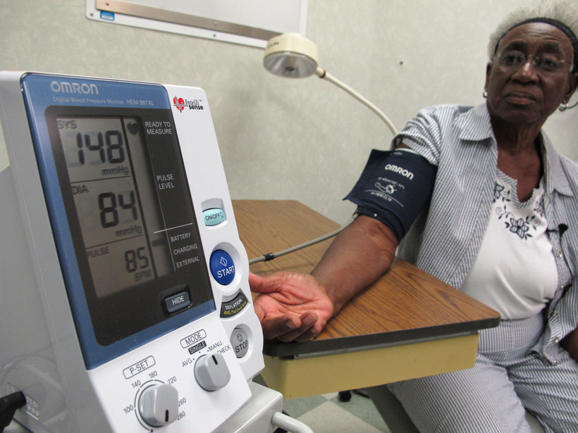 Woman gets blood pressure checked
