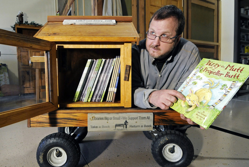 Todd Bol, founder, poses with a Little Free Library lending box