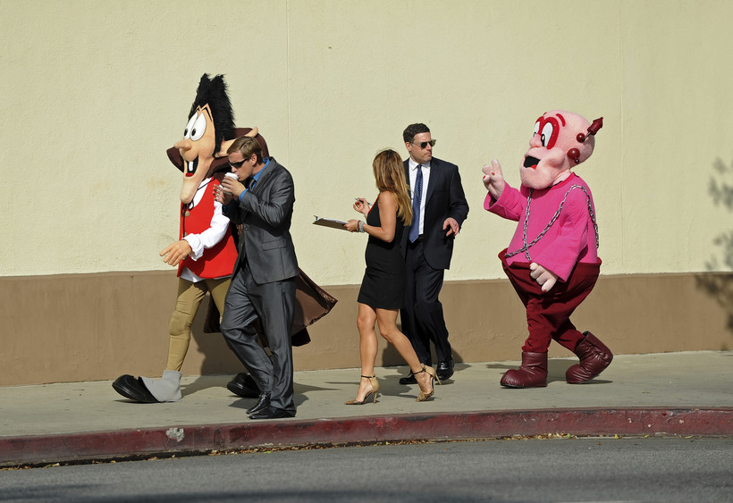 Cereal mascots Count Chocula and Frankenberry, along with their agents and producer, walk while discussing current projects
