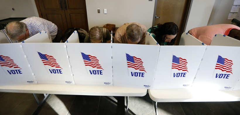 Voters casting election ballots