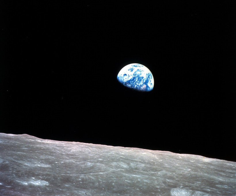 Earth behind the surface of the moon