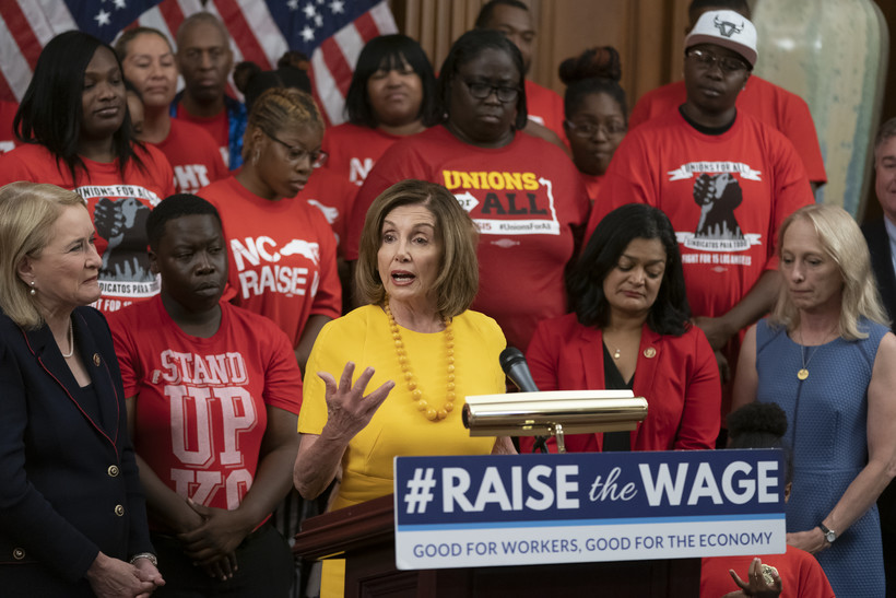 Speaker of the House Nancy Pelosi with advocates for $15 minimum wage