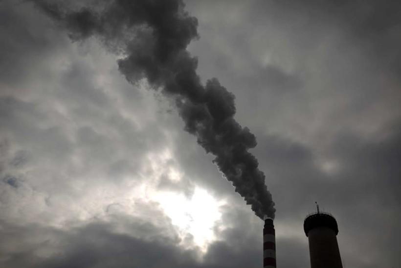 Smoke plume rises from smokestack