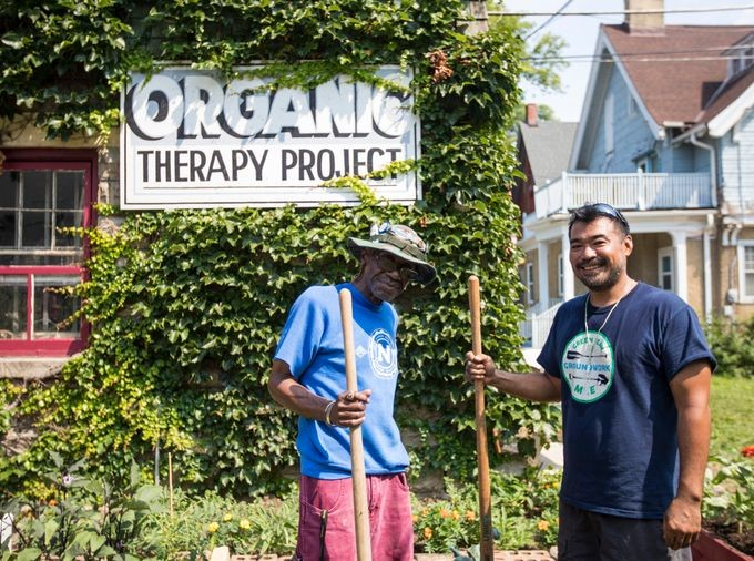 Brian Sales and a veteran work at a community gardenin Milwaukee.
