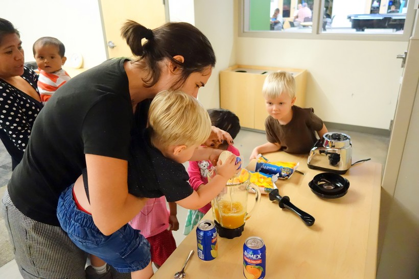 Chef Lily Kilfoy teaching young children to cook at classes held in a local library