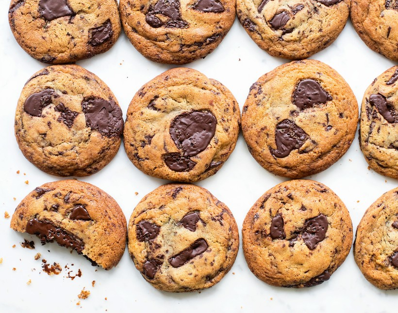 Chocolate chip cookies lined up in a grid formation