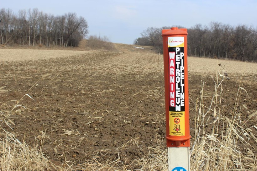 An Enbridge post marks the Line 61 corridor in a field in Marshall, Wisconsin.