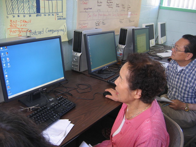 Seniors looking at computer screens