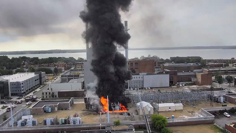 Black smoke rises from a fire at a substation in Madison, Wis. on July 19, 2019