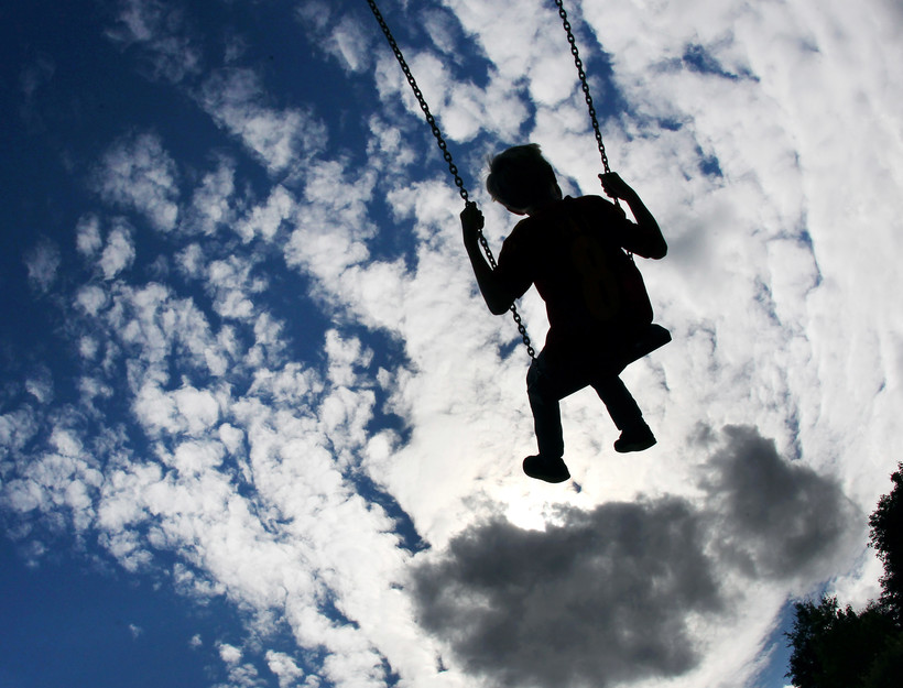 child on swings