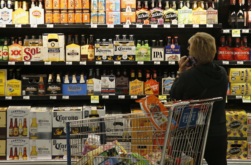 A customer looks over the beer selection