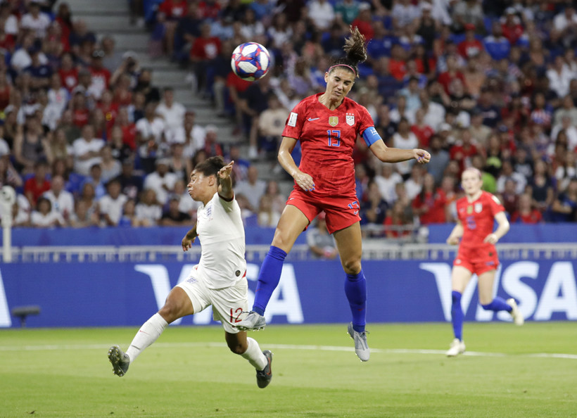 United States' Alex Morgan, right, scores her side's second goal, during the Women's World Cup semifinal soccer match between England and the United States on July 2, 2019..
