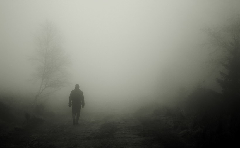 figure walking in fog
