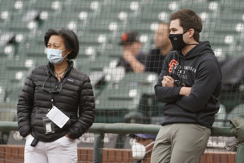 Miami Marlins general manager Kim Ng chats with a colleague before a game