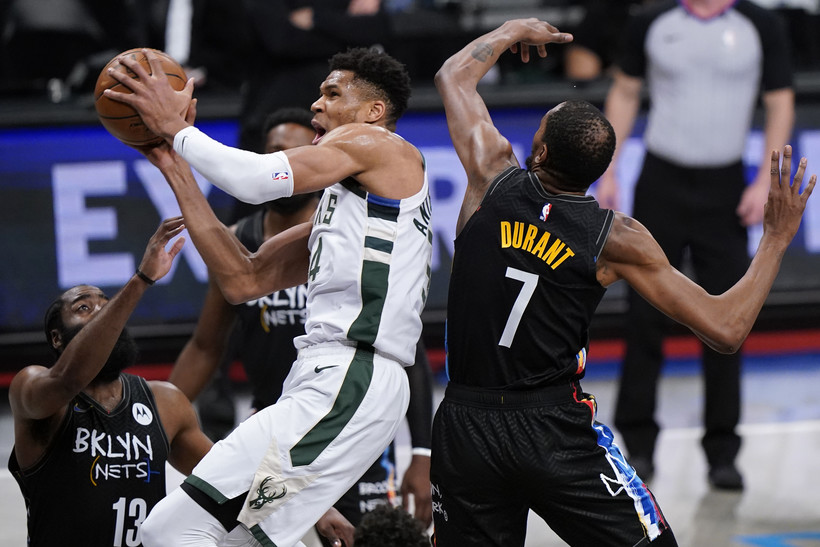 Nets' James Harden and Kevin Durant try to contain Bucks forward Giannis Antetokounmpo