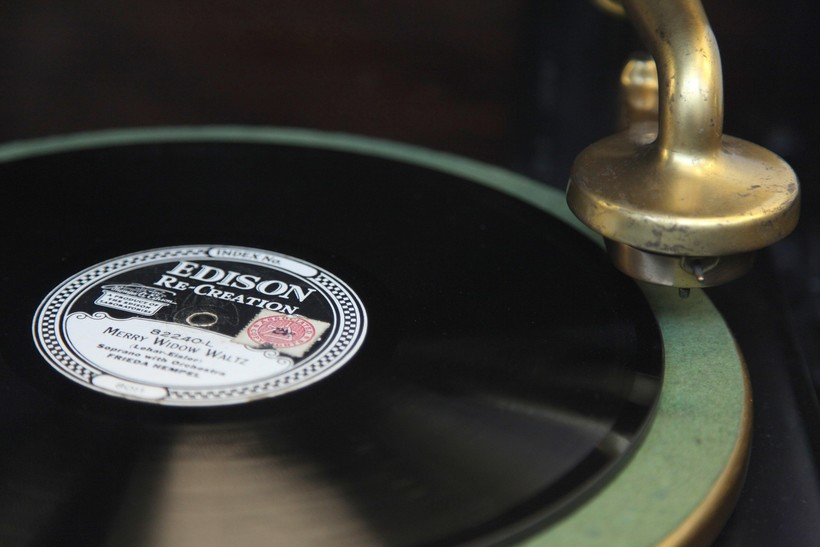 A vintage record player poised for the needle to drop