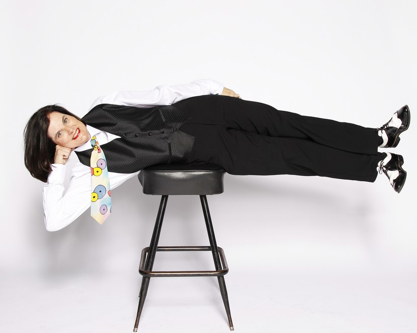 Paula Poundstone planking on a stool