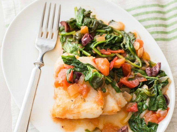 A photo of a fish and spinach dish