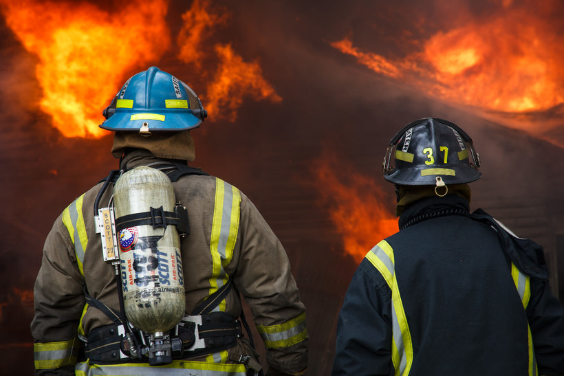 Two firefighters fighting a fire