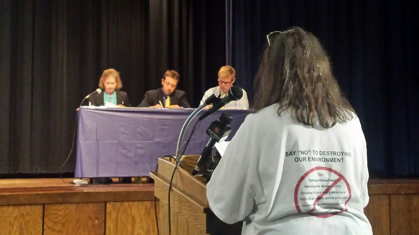 A member of Friends of the Black River Forest (right) testifies at Wednesday night's DNR hearing in Sheboygan Falls.