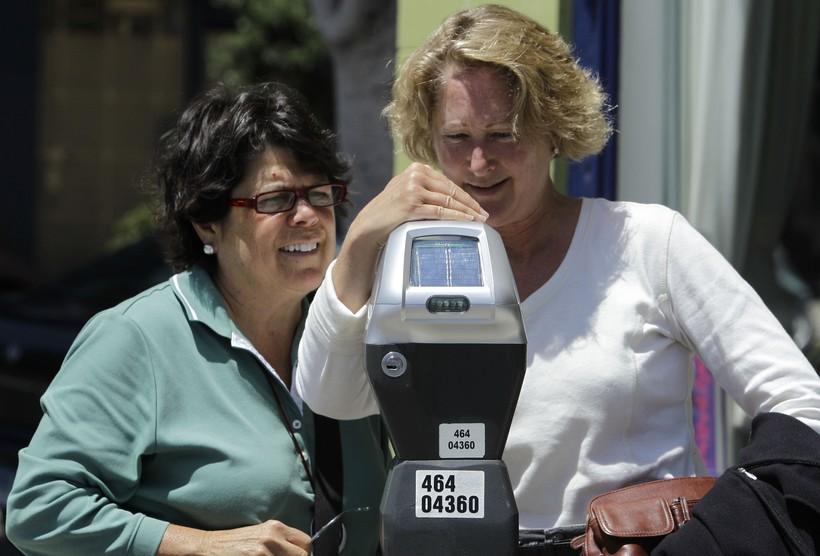 Women at parking meter