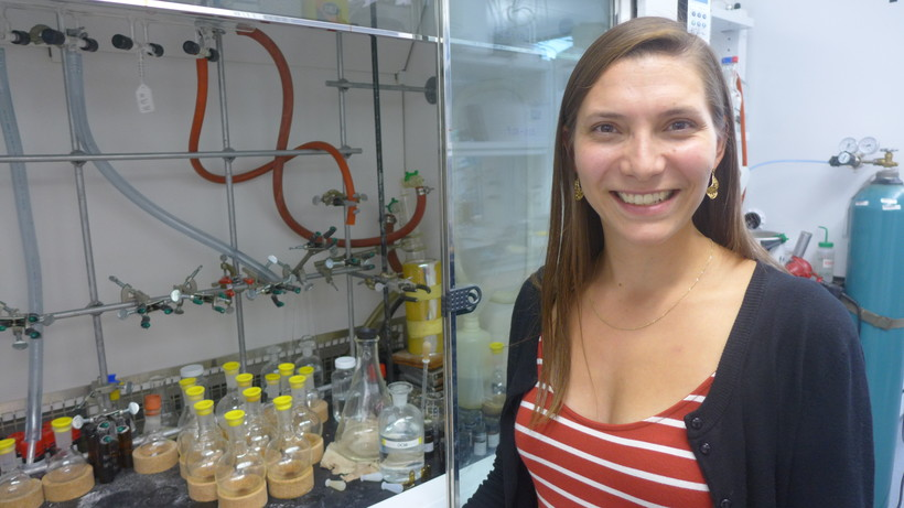 Post-doc researcher Rebecca Smith next to her fume hood