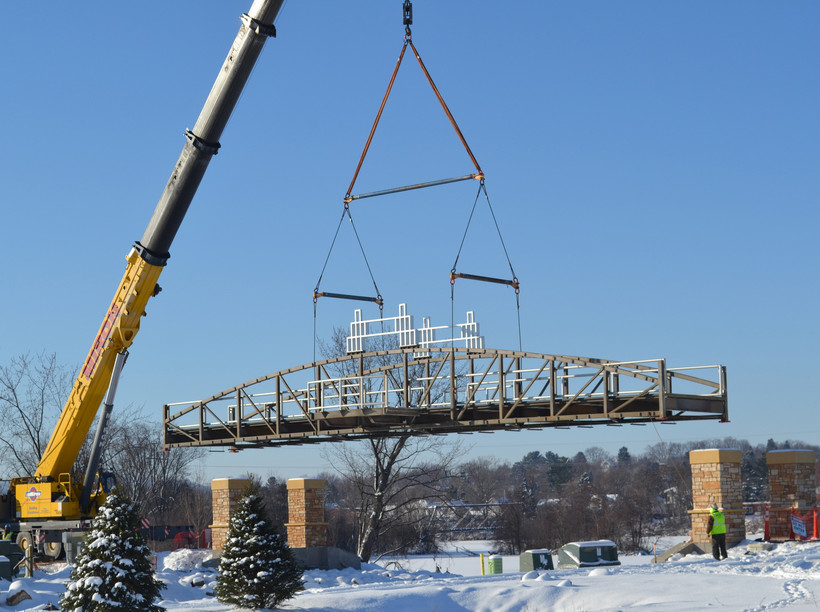 A crane lowering a bridge