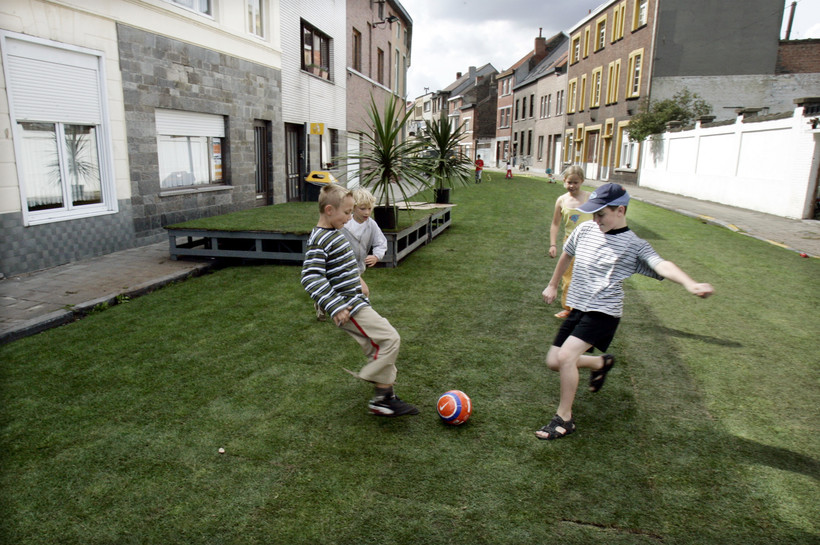 Children playing in street outside homes