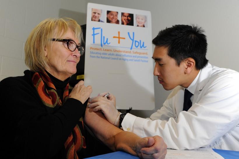 Woman receiving a flu shot