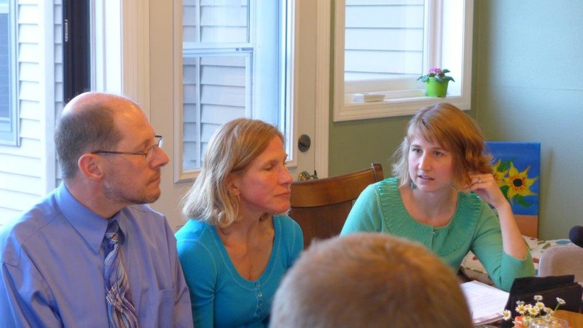 """Dr. James Milford and his wife, Karen, in a family conversation about advance care planning  """"facilitated"""" by Erin Aagesen, (right)  a community engagement specialist for Honoring Choices Wisconsin."""