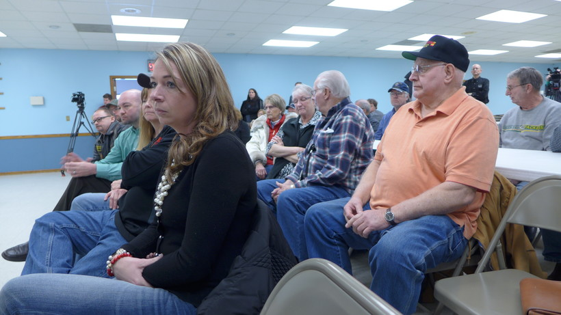 Jason Simcakoski's widow, Heather (left), listens to veterans and Tomah VA staff share their experiences with the medical center at a state lawmaker town hall meeting held in Tomah in February 2015.