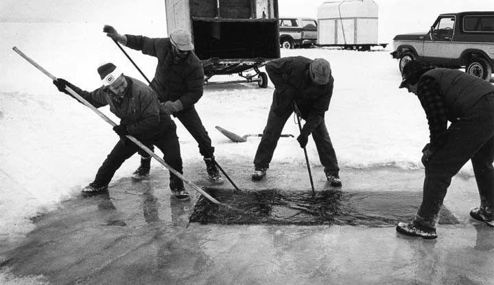 Cutting sturgeon spearing hole near Fire Lane 8, Menasha in 1983.
