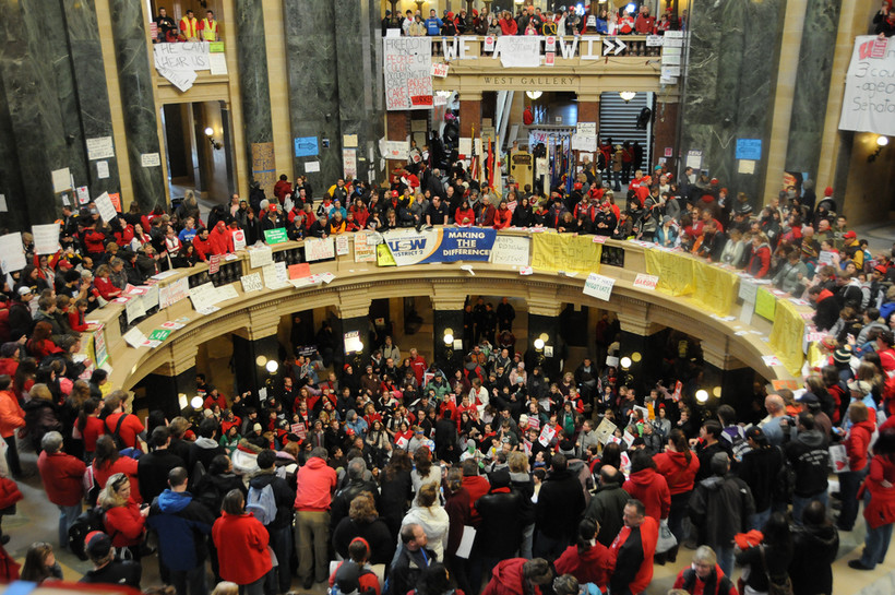 Wisconsin Capitol with large crowd of protestors