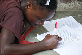 Doing Homework, photo by Wikimedia Commons user Alex Proimos