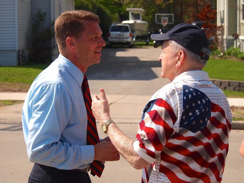 State Sen. Joe Leibham talking with veteran
