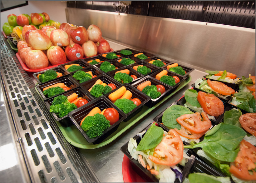 School lunch trays filled with food