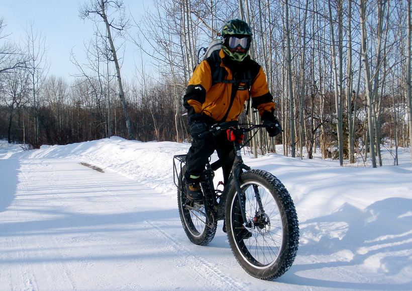 Rider on a fat tire bike doing winter trail riding