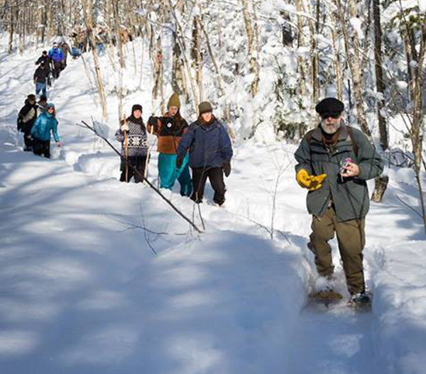 A small group of people snowshoed in the off-limits area near the proposed mine site in the Penokee Hills. Photo: Justus Grunow