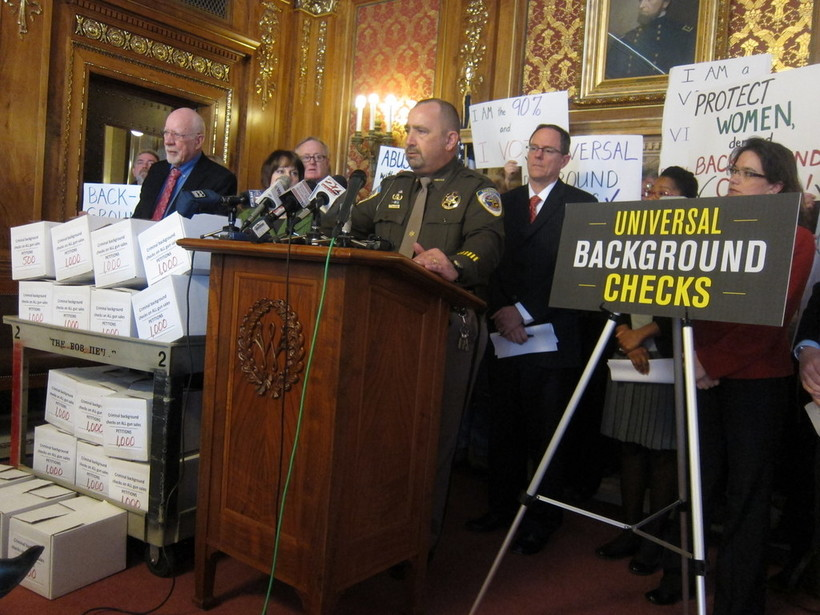 Dane County Sheriff Dave Mahoney speaks at a state capitol press conference as advocates deliver 16-thousand petitions in favor of universal background checks for firearms.
