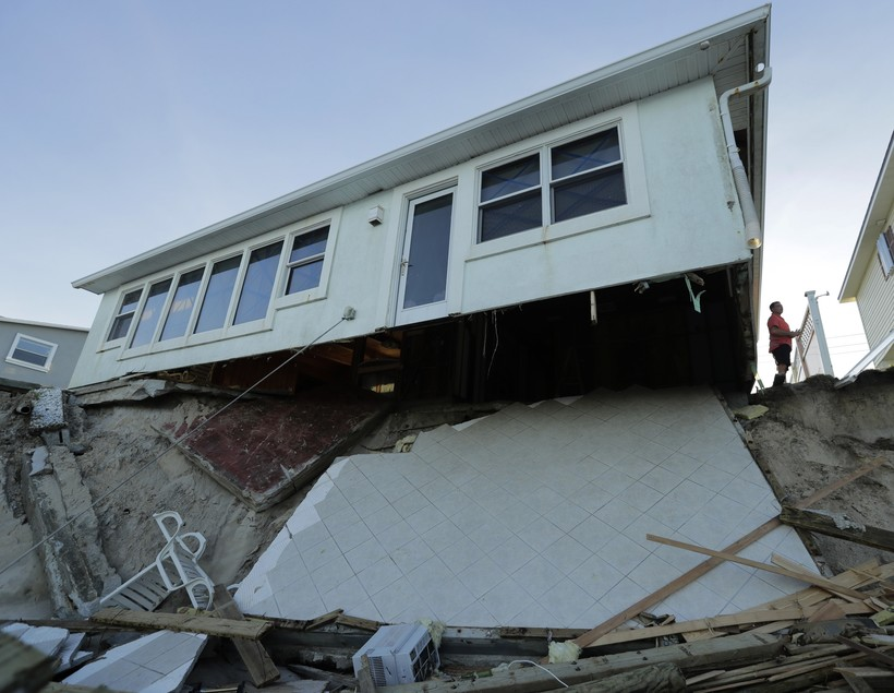 House hanging over broken foundation