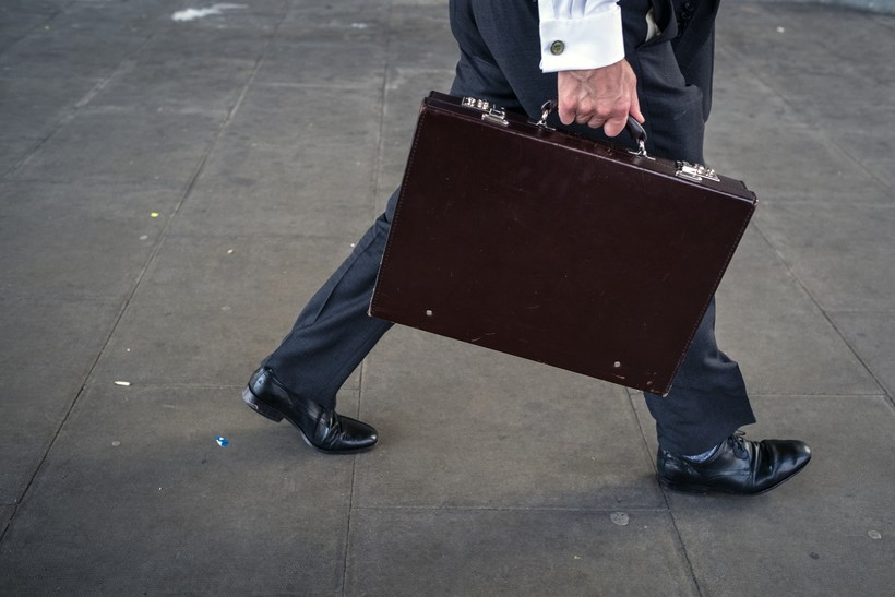 Person walking with briefcase