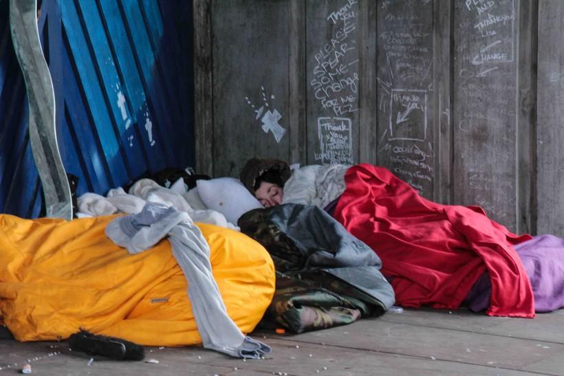 Sleeping homeless woman