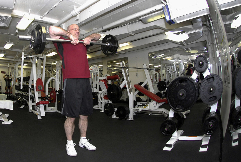 older man lifting weights