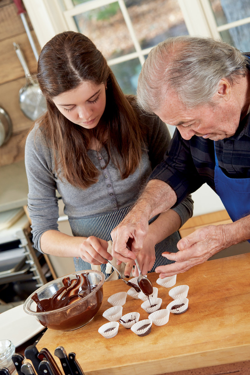 Jacque Pepin and his granddaughter - Shorey - make chocolate desserts in a kitchen