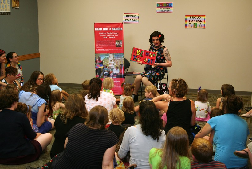 Miss Gretta reading at the first Drag Queen Story Hour at Madison's Pinney Library