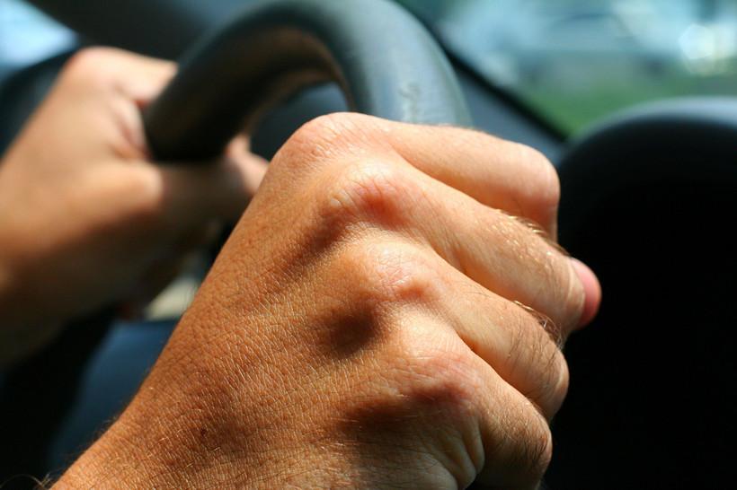 hands on steering wheel in car, traffic, road rage