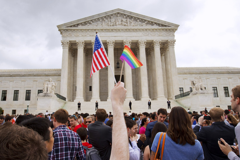 The crowd celebrates outside of the Supreme Court in Washington, Friday June 26, 2015, after the court declared that same-sex couples have a right to marry anywhere in the US