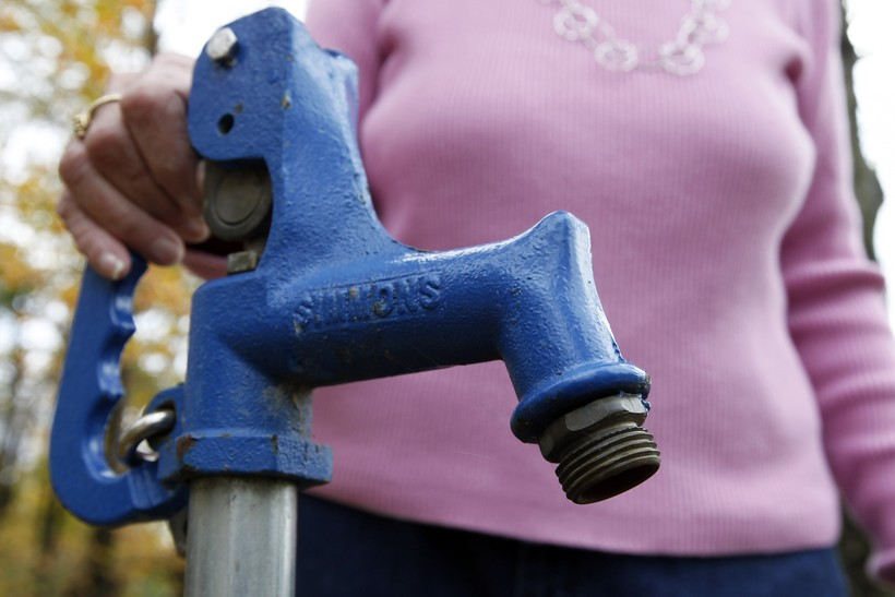 Jean Carter with the water spigot used to test her well water